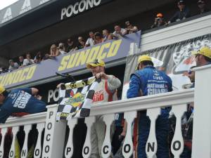 Dale Earnhardt Jr celebrates in Victory Lane at Pocono Raceway.