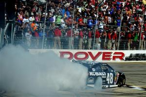 Jimmie Johnson does a celebratory burnout at Dover. Photo by Rainier Ehrhardt/Getty Images