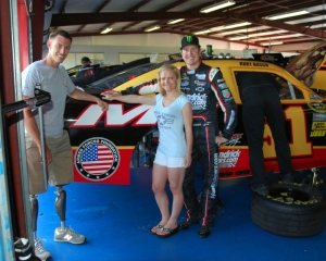 Kurt Busch and Patricia Driscoll stand with a disabled veteran in front of Busch's car. Photo from http://www.armedforcesfoundation.org/wp-content/uploads/2014/02/DSC_0669.jpg