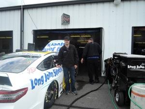 David Gilliland stands by his car at Pocono Raceway.
