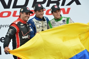Carlos Huertas, Juan Pablo Montoya, and Carlos Munoz celebrate on the podium after Race 1. Photo by Chris Jones.