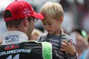 Sebastien Bourdais celebrates his win in Toronto with his son. Photo by Shawn Gritzmacher.