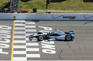 Juan Pablo Montoya crosses the finish line in Pocono. Photo by Bret Kelley.
