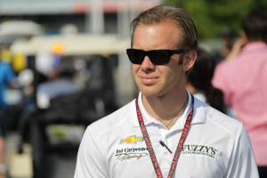 Ed Carpenter walks through the paddock before practice on Friday.  Photo by Joe Skibinski.