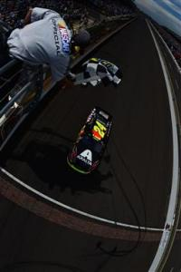 Jeff Gordon takes the checkered flag on Sunday to win the Brickyard 400 for his fifth time. Photo by Patrick Smith/NASCAR via Getty Images