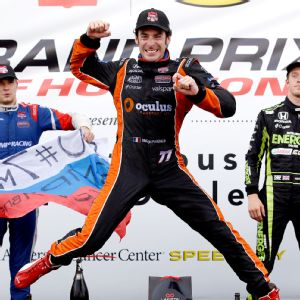 Simon Pagenaud celebrates his victory after the second race in Houston. Photo by AP Photo/David J. Phillip.