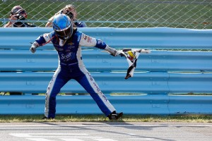 AJ Allmendinger celebrates his first career win at Watkins Glen. Photo by Tom Pennington/Getty Images North America.