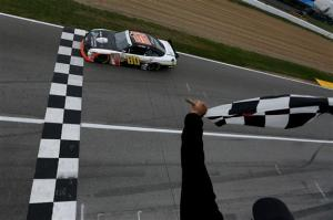 Chris Buescher takes the checkered in a dramatic finish for his first Nationwide Series win. Photo by Nick Laham/Getty Images.