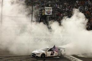 Brad Keselowski celebrates his win at Richmond International Raceway on Saturday night. Photo by Rainier Ehrhardt/Getty Images