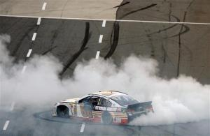 Dale Earnhardt Jr celebrates his win in Martinsville. Photo by Jared C. Tilton/NASCAR via Getty Images